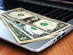 dollar in laptop 240x180 - Offline and Online Gambling: Advantages and Disadvantages